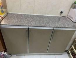 kitchen cabinet with marbles slip