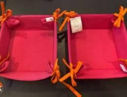 2 pink cloth trays